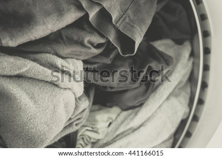 Clothes in washing machine.black and white Vintage tone.Selective focus. - stock photo
