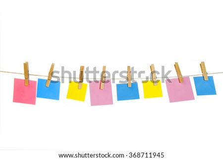 Clothes line with clothes pins holding onto an assortment of shaped text area pieces of paper.  Isolated on white,  Pink, yellow, blue - stock photo
