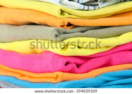 clothes neatly folded and lying on top of each other close up - stock photo