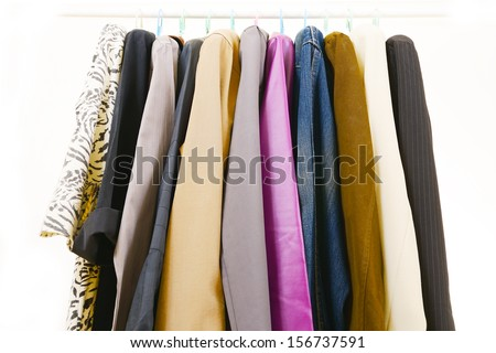 Clothes of different colors on vintage metal hanger - stock photo