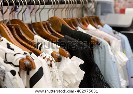clothes on a hanger in clothes shop - stock photo