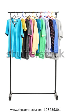 Clothes on hang rail, isolated on white background - stock photo