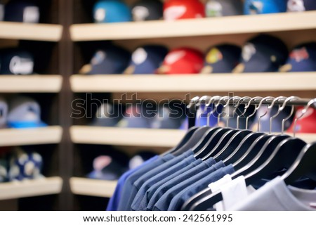 Clothes on hangers at a clothing store - stock photo