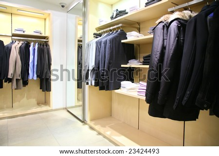 clothes on racks in shop - stock photo