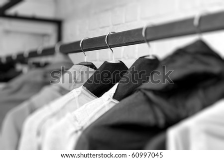 clothes on racks in store - stock photo