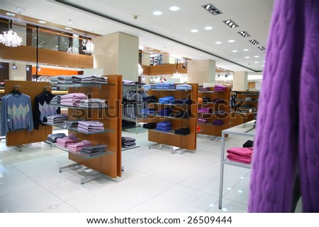 Clothes on shelves in shop - stock photo