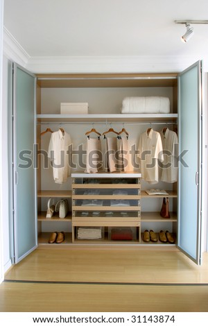 clothes organized in closet - stock photo