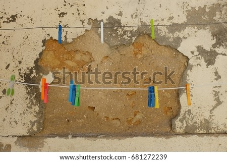 Clothes-pegs and wall
