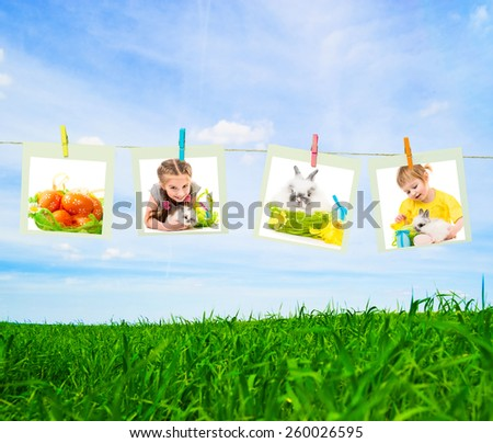 Clothes pin holding Easter photos outdoors - stock photo