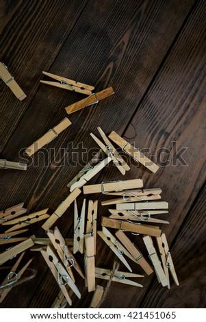 clothes pin on oak wooden table - stock photo