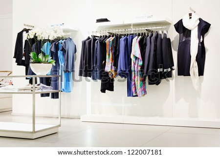 Clothes rack in shopping center - stock photo