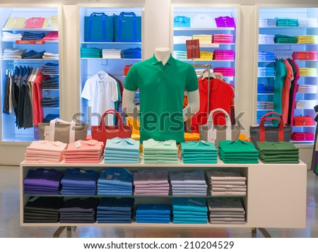 clothes shop with shirt hanged on stand - stock photo