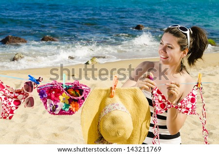 Clothes to dry on the beach - stock photo