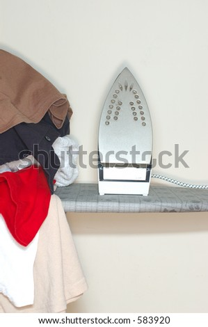 Clothes waiting to be ironed (high key) - stock photo
