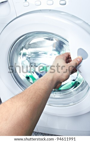 clothes washer with arm and green fabric