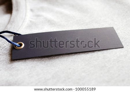 Clothes with blank label. - stock photo
