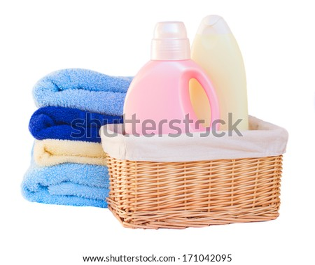 Clothes with detergent  in basket isolated on white background - stock photo
