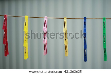 clothespin clothespins on rope vector background - stock photo