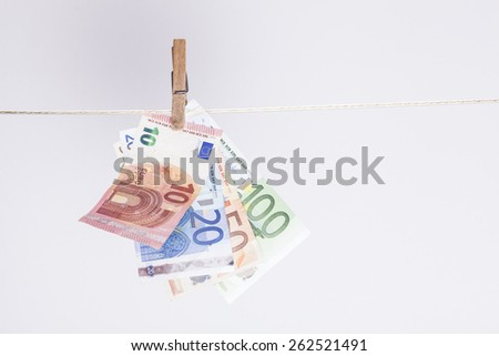 clothespin fixing some euro banknotes on a clothes line. financial concept or background for money laundering