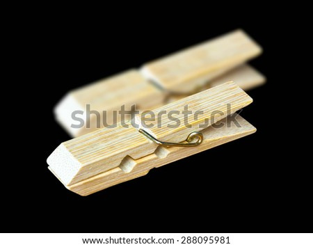 Clothespin isolated on a black background. - stock photo