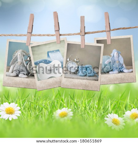 Clothespin on a laundry line with photos - stock photo