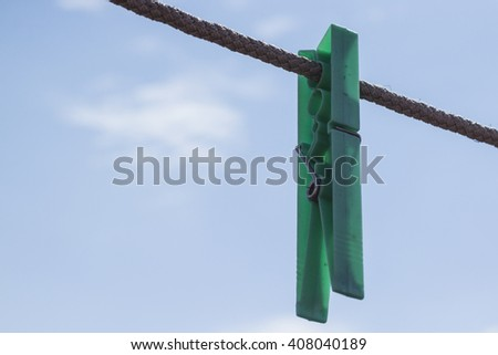 clothespin on rope - stock photo