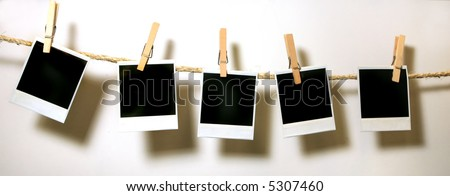 Clothespins Holding Vintage instant photo Grunge Frames - stock photo