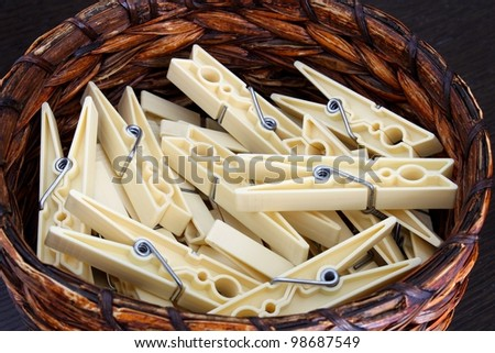clothespins in a wicker basket - stock photo
