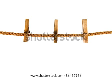 clothespins on a rope isolated on the white background - stock photo