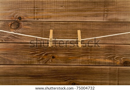 clothespins on a wooden background - stock photo