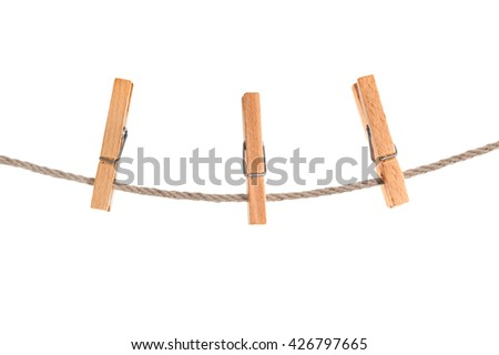 clothespins on rope isolated - stock photo