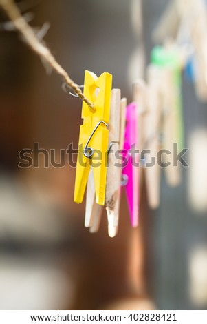 Clothespins on the clothesline. Wood en plastic. Colorful. - stock photo