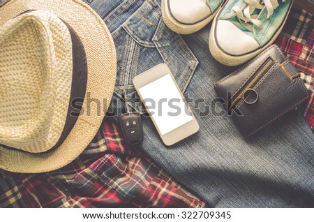 Clothing accessories, shirts, jeans and sneakers smartphone wallet.smart phone   - stock photo