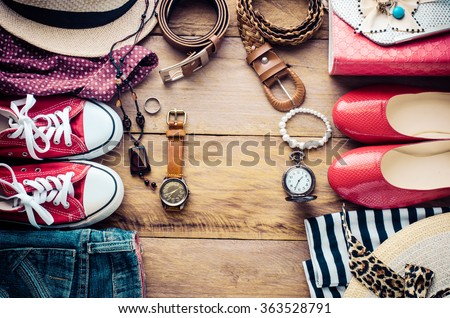 Clothing and accessories for men and women ready for travel. - stock photo