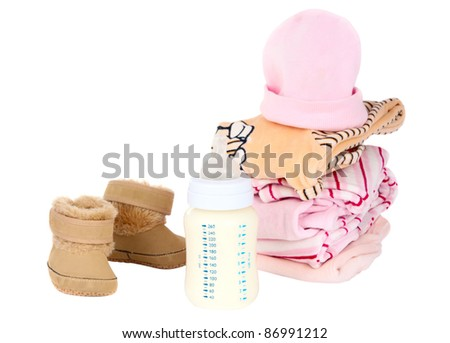 clothing and baby milk bottle on a white background - stock photo