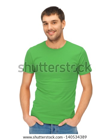 clothing design concept - handsome man in blank green t-shirt - stock photo