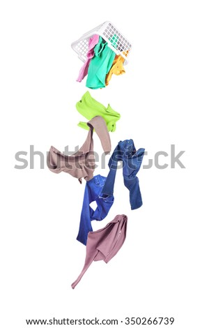Clothing drops of laundry baskets isolated on white - stock photo