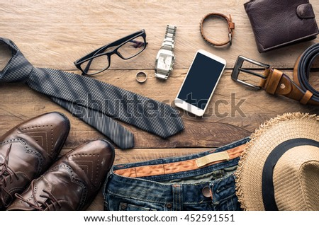 Clothing for Men on the wooden floor - stock photo