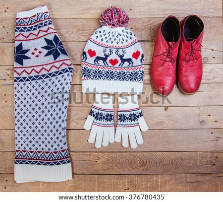 Clothing for winter. jumper, hat and boots - stock photo