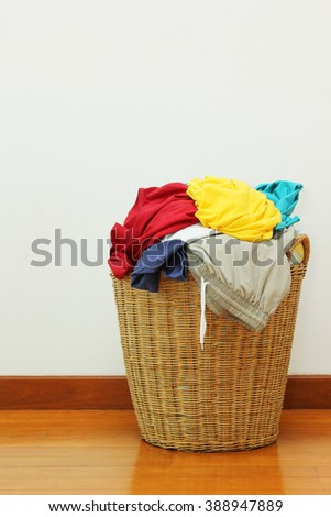 Clothing in laundry basket made of rattan
