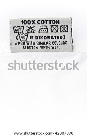 clothing label washing instruction tag on white t-shirt - stock photo