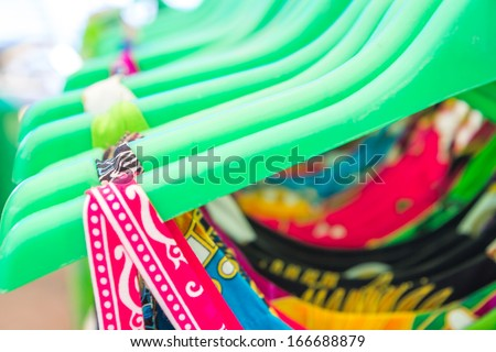 clothing on hangers at the show - stock photo