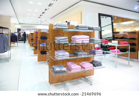 Clothing on shelves in store - stock photo