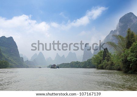cloud and mist amidst the lijiang river,guilin,China - stock photo