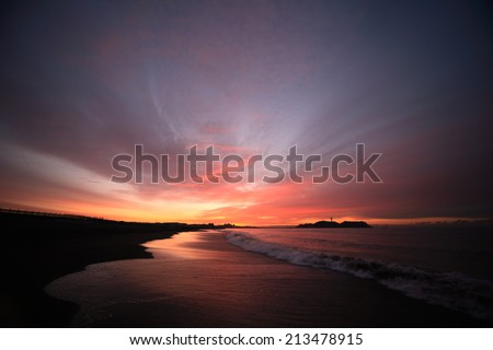 Cloud and shore and Enoshima of the morning glow - stock photo