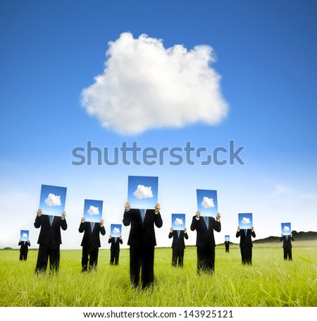cloud computing and business thinking concept. businessman showing cloud thinking board on the field - stock photo