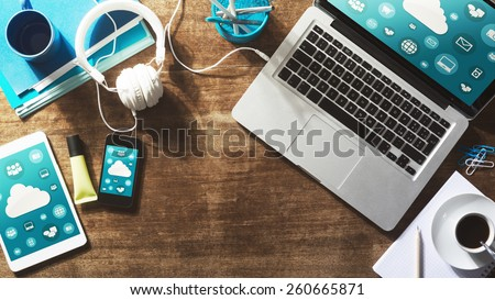 Cloud computing and social network interface on a laptop, tablet and smartphone screen - stock photo