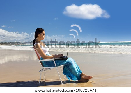 Cloud computing: Asian woman Working at the beach - stock photo