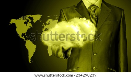 Cloud computing concept, close up of young businessman with cloud over his hand - stock photo
