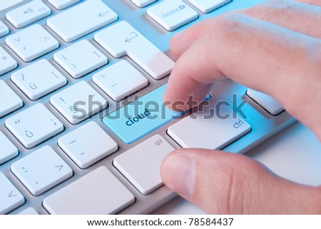 Cloud computing concept - computer keyboard with cloud button - stock photo